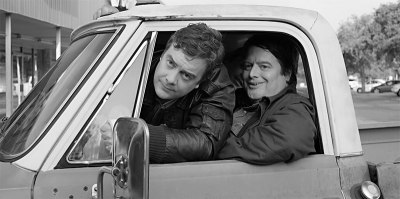 Bill (Macon Blair) and John (John Merriman) sitting in a truck in Mustang Island