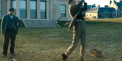 Tommy Morris (Jack Lowden) playing golf while Tom (Peter Mullan) watches in Tommy's Honour